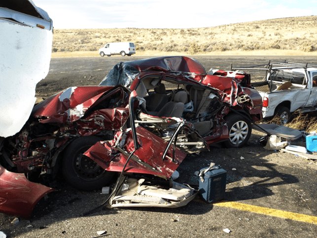 Multi-vehicle-semi-truck-collision-wrecked-car